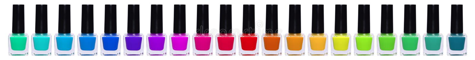 A large set of multi-colored nail polishes. Rainbow jars with nail polish royalty free stock photography