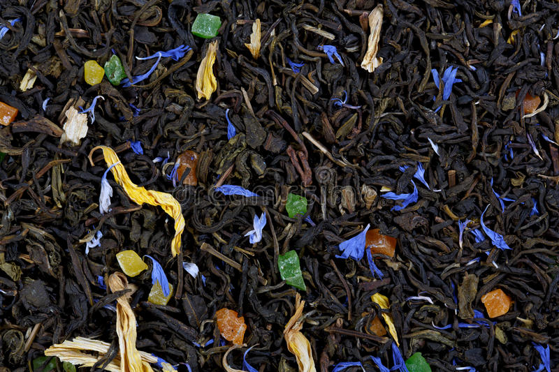 A large sheet of green tea, cornflower petals, sunflower petals, royalty free stock photo