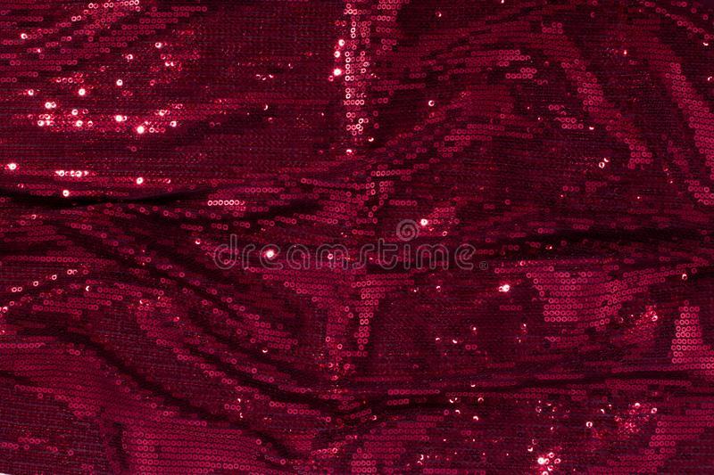 Large shiny glossy red - burgundy sequins background. royalty free stock photography
