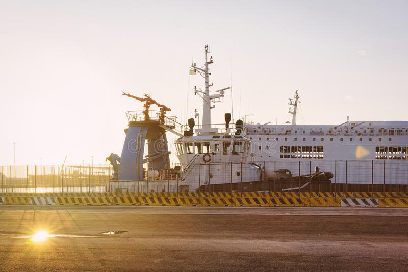 Large ship at Mediterranean Sea in Port Civitavecchia Italy sunset. Large ship at the Mediterranean Sea in Port of Civitavecchia in Italy. At sunset royalty free stock images