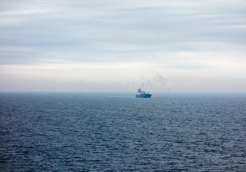 Large ship travelling in the North Sea in fog. KATTEGAT, NORTH SEA - MAY 16, 2017: A large ship travelling in the Kattegat strait between Sweden and Denmark in royalty free stock photo