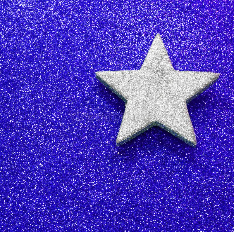 large silver star on blue bright background royalty free stock photo