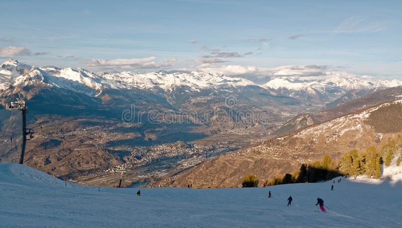 Nendaz ski slopes and the Rhône Valley in Switzerland. The large ski resort of Nendaz in the Swiss alps, part of the 4 Valleys ski area, the largest in royalty free stock photo