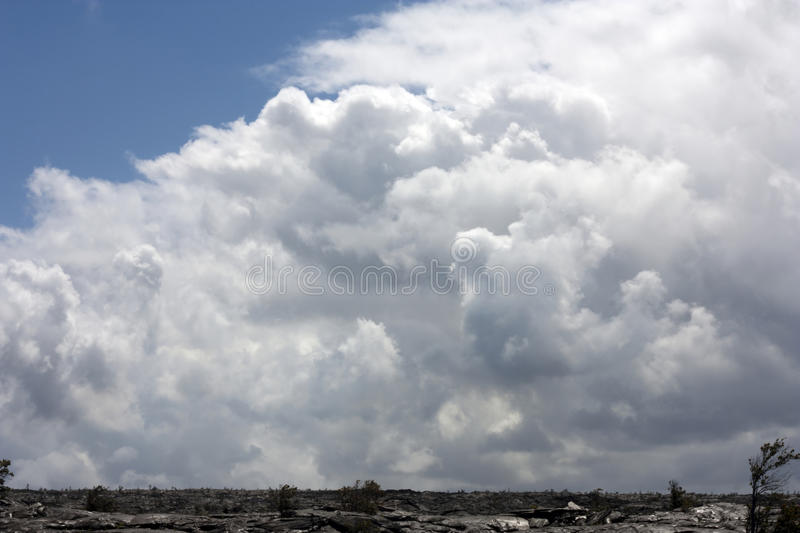 Large Sky Of Clouds Over Lava Field Stock Image