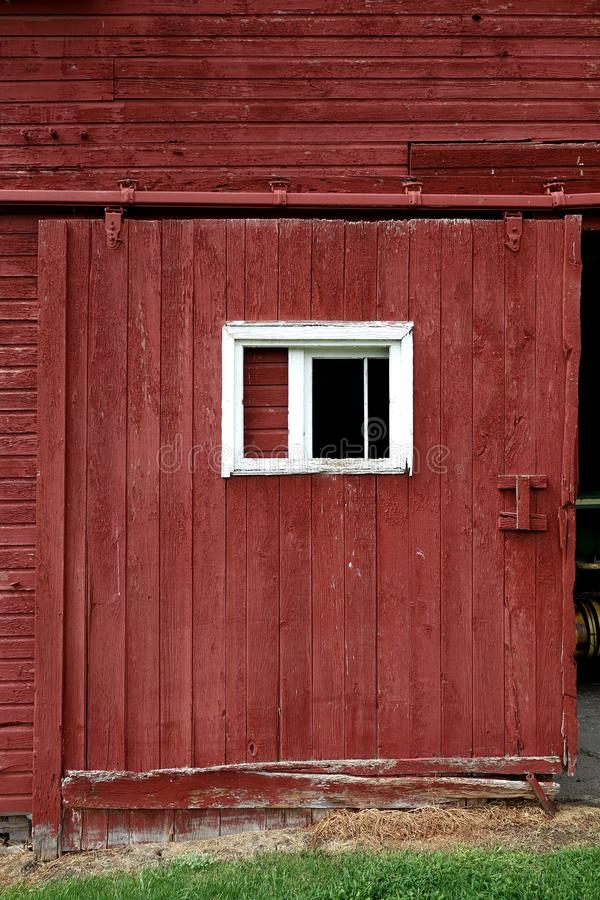 Red Barn Door with White Trim Window stock photos