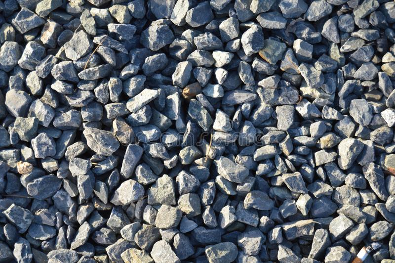 Large and small blue pebbles stone texture royalty free stock photo