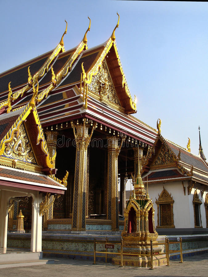 Large and small highly detailed temples at the Grand Palace royalty free stock images