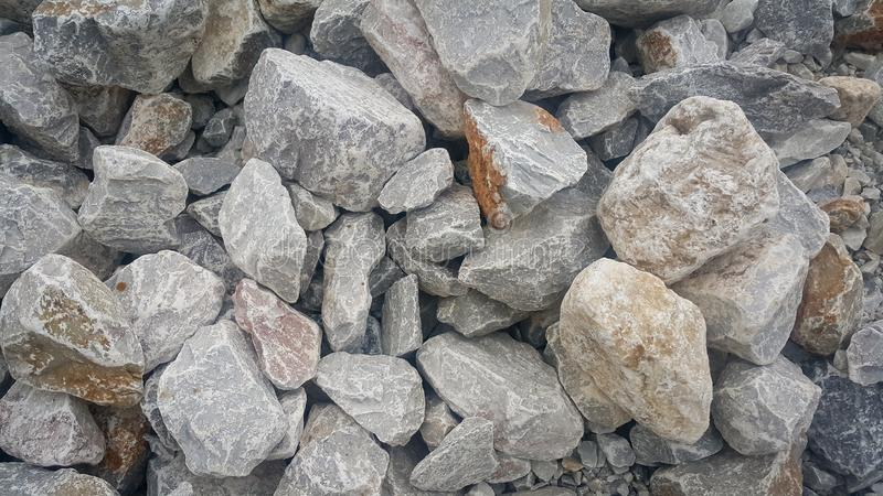 Large and small piles of limestone for use in lime kiln line royalty free stock image