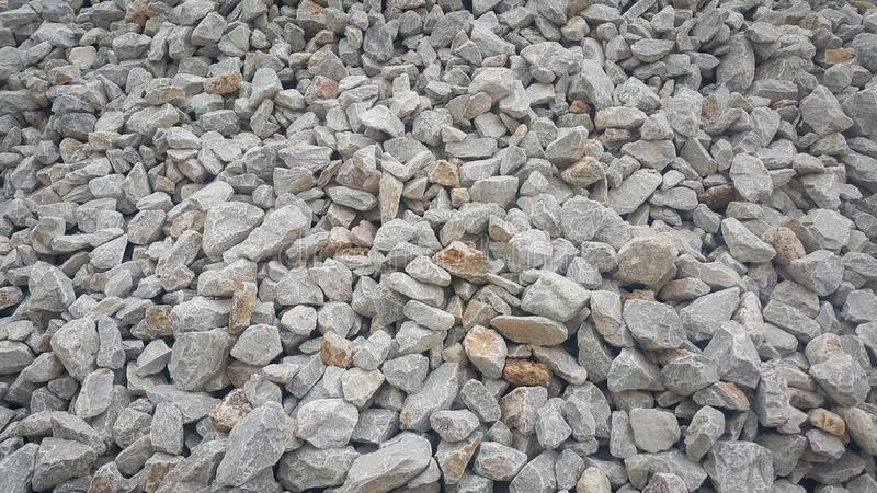 Large and small piles of limestone for use in lime kiln line . royalty free stock photo