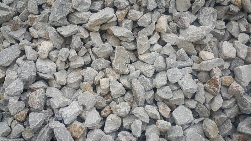 Large and small piles of limestone for use in lime kiln line . stock image