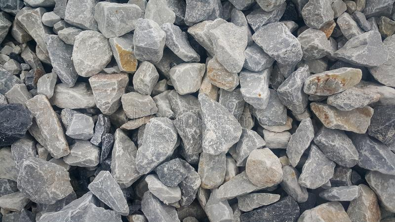 Large and small piles of limestone for use in lime kiln line royalty free stock photos