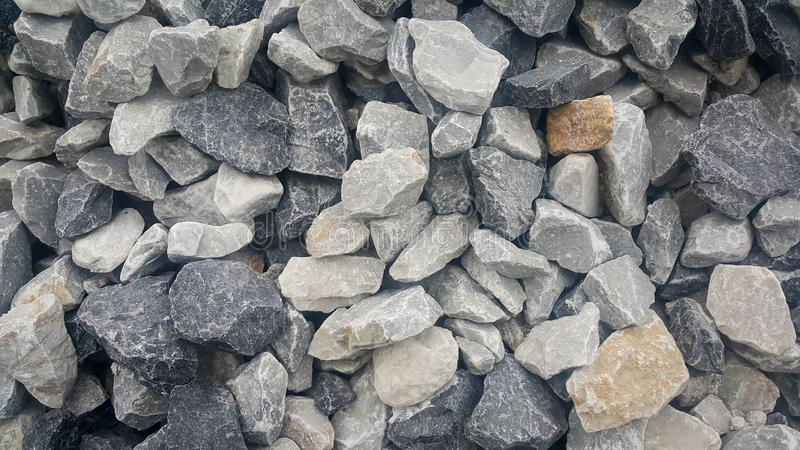 Large and small piles of limestone for use in lime kiln line . stock photo