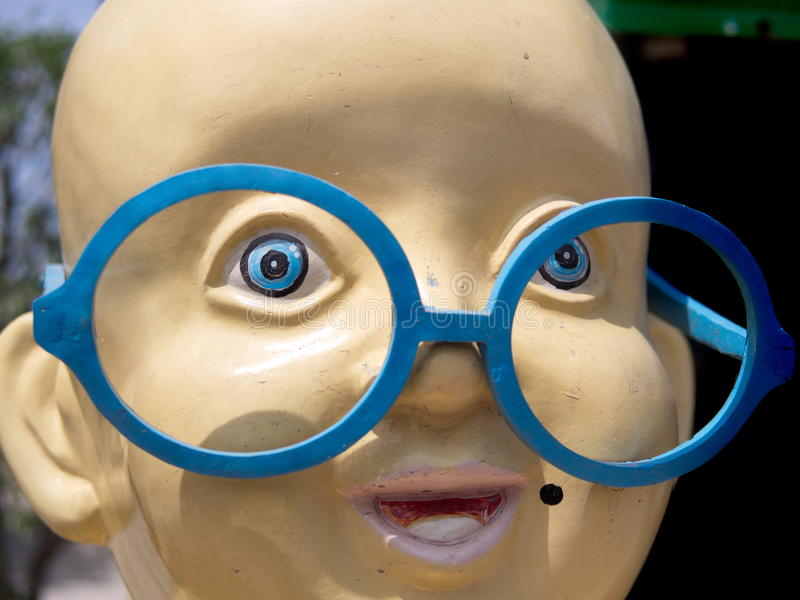 Large smiling face with huge glasses stock photo