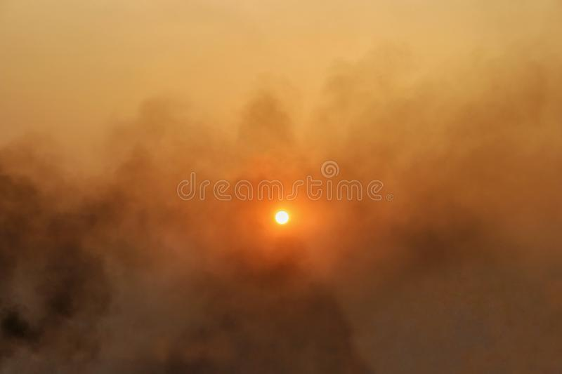 Large smoke Covered on sky with light of evening sun causing the beautiful of the sky. - image. Large smoke Covered on sky with light of evening sun causing the stock image