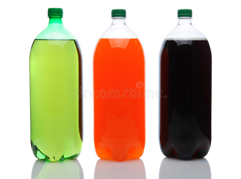 Large Soda Bottles on White. Cola, Lemon Lime and Orange two liter soda bottles on a white background with reflection royalty free stock image