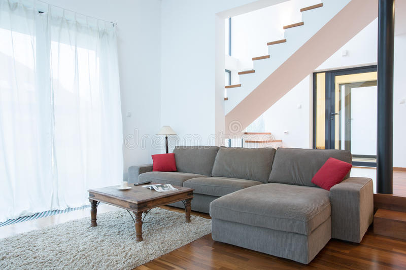 Large sofa in spacious living room stock photos