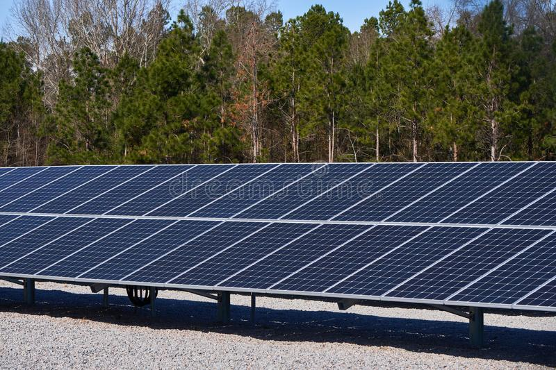 A large Solar Panel used for collection of sun energy. A group of large solar panels used for the collection of renewable energy from the sun royalty free stock image