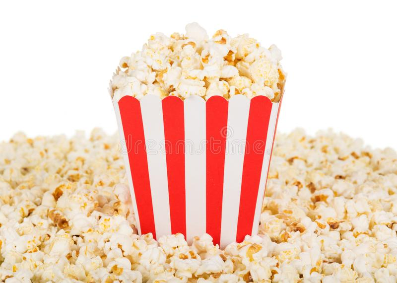 Large square box popcorn and are many around, isolated on white. royalty free stock images