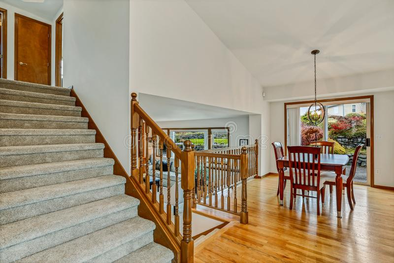 Large staircase with view of living room and dining room royalty free stock photos