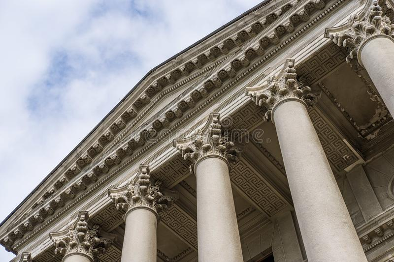 Large stately columns with a roof. Vintage stock photo