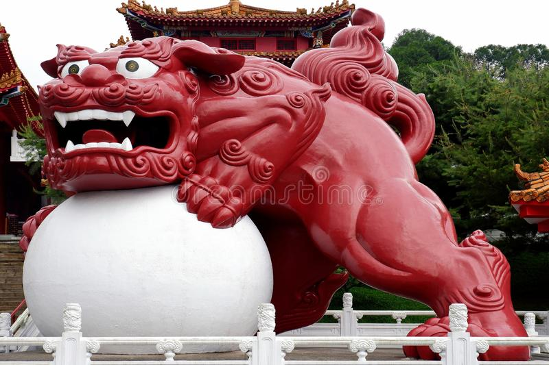 Large Statue of Red Guardian Lion stock photo