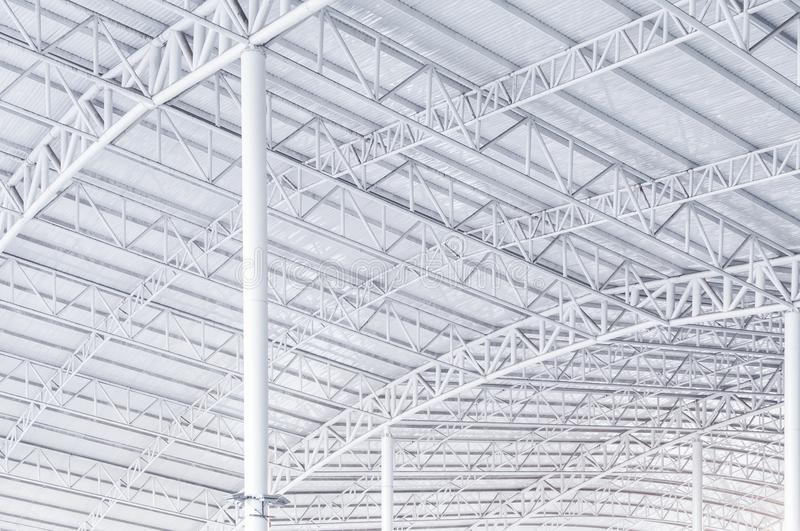 Large steel structure truss, roof frame and metal sheet in building. Construction site stock photography