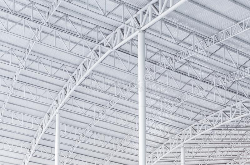 Large steel structure truss, roof frame and metal sheet in building. Construction site stock images