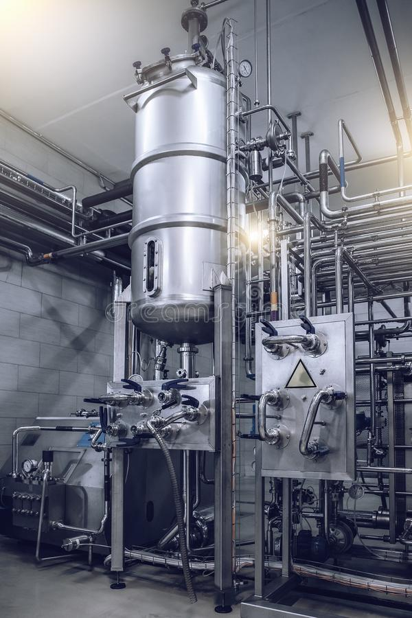 Large steel tanks or reservoirs in beverage factory interior, industrial hardware equipment, juice production plant.  royalty free stock photography