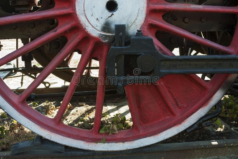 Large steel wheels of old steam locomotive red with white outline stock photography