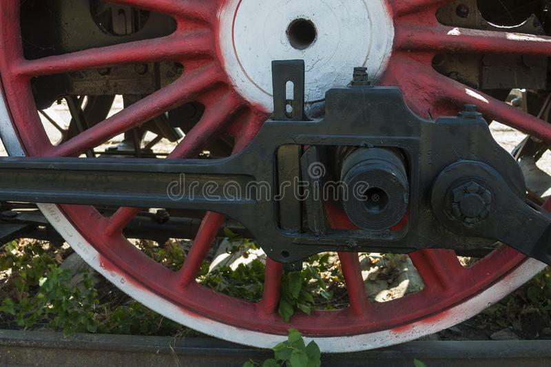 Large steel wheels of old steam locomotive red with white outline stock images