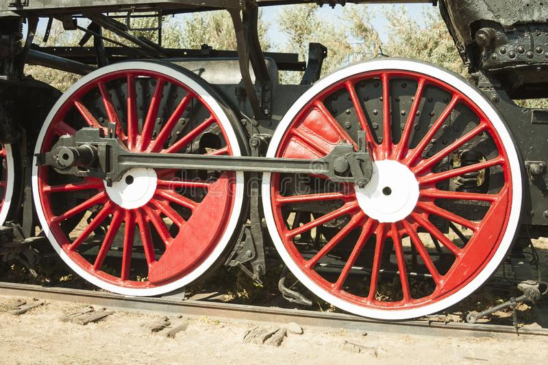 Large steel wheels of old steam locomotive red with white outline stock photos