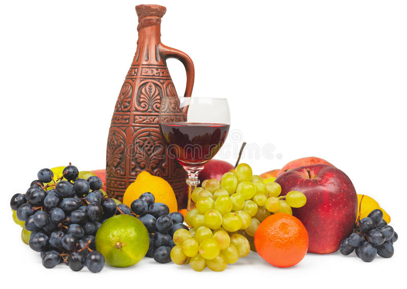Large still life - clay bottle, glass and fruits. Large still life - a clay bottle, glass and fruits, isolated on a white background royalty free stock photography