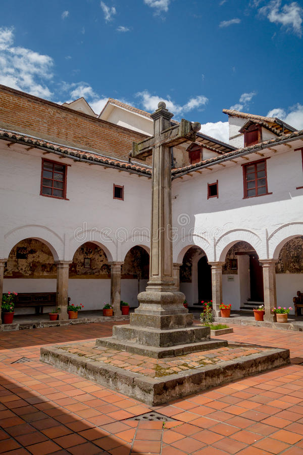 Large stone cross located inside courtyard of San royalty free stock photography