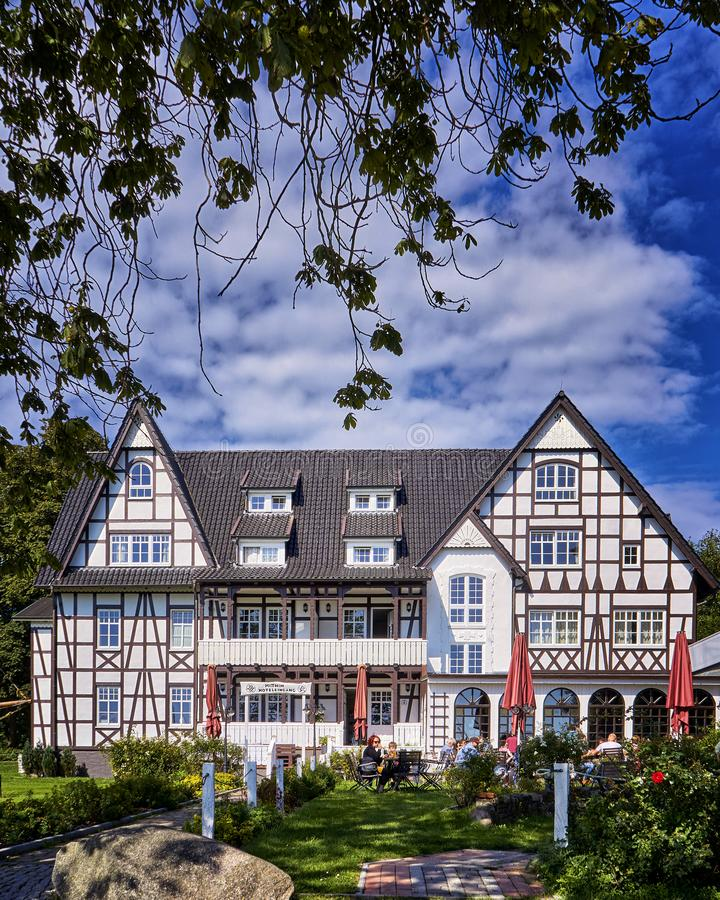 Large stone at the entrance to the half-timbered house in Kloster on the island Hiddensee. Hotel, building, architecture, tourism, accommodation, amazing royalty free stock images