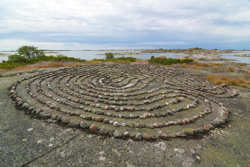 Large stone labyrinth Fredlarna archipelago. Large stone labyrinth on a flat rock in Stockholm outer archipelago island Stora Bredskär, Fredlarna. Sweden royalty free stock image