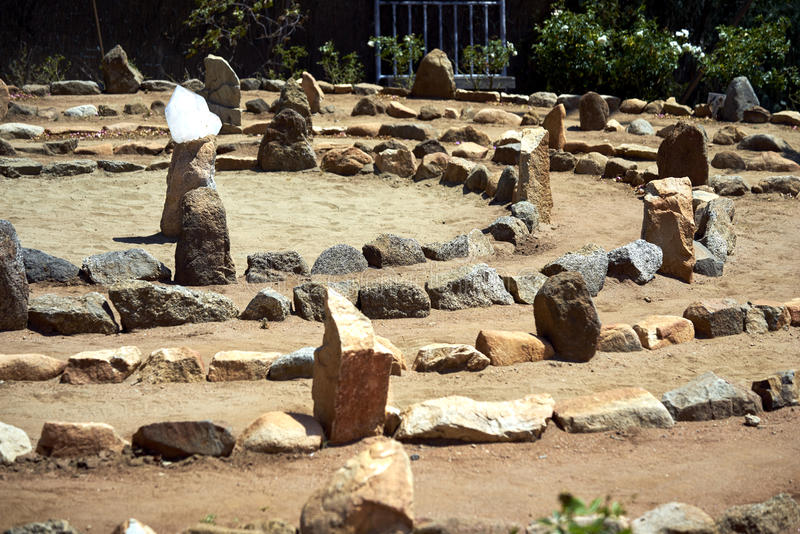 Large stone and sand labyrinth bathed in the mid-day sun stock photography