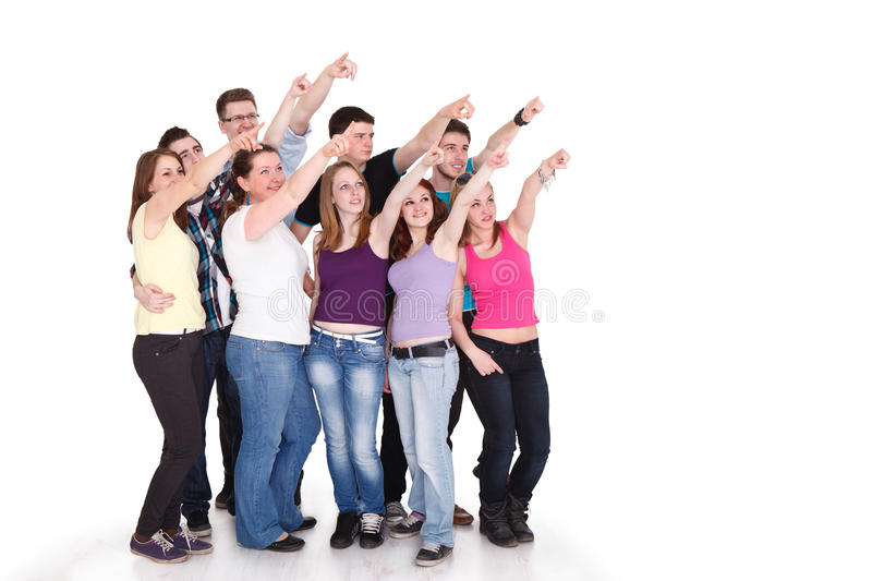 Large students group pointing at copy space royalty free stock photo