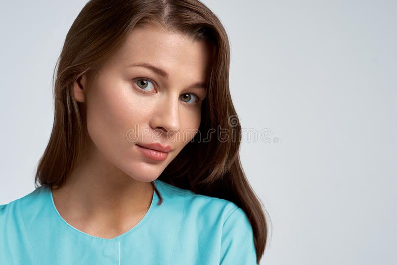 Large Studio portrait of a young beautiful woman with dark hair and clean healthy skin. Expressive eyes and calm expression stock photography