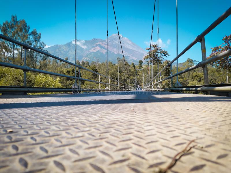 A large suspension bridge with a mountain background royalty free stock images