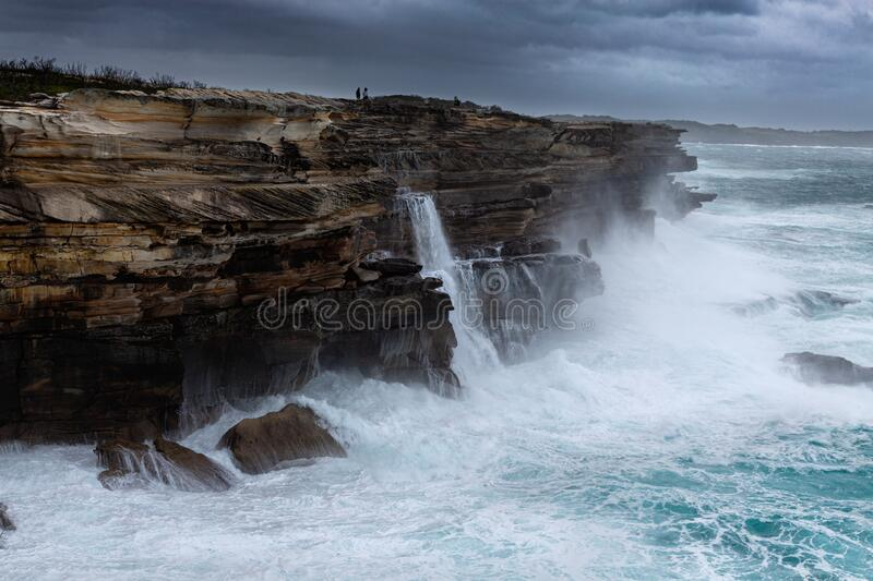 Large swells batter the cliffs of Sydney royalty free stock images