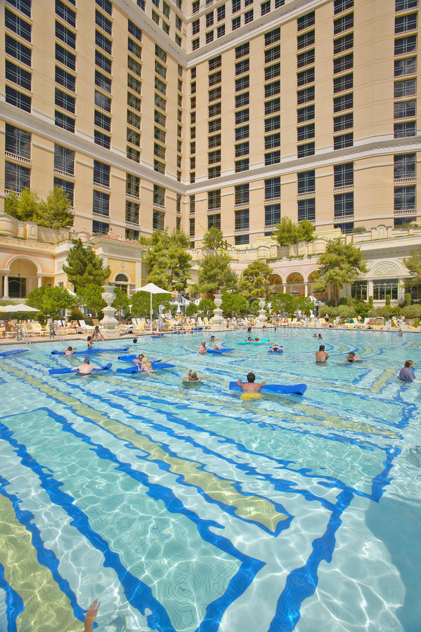 Large swimming pool with swimmers at Bellagio Casino in Las Vegas, NV royalty free stock images