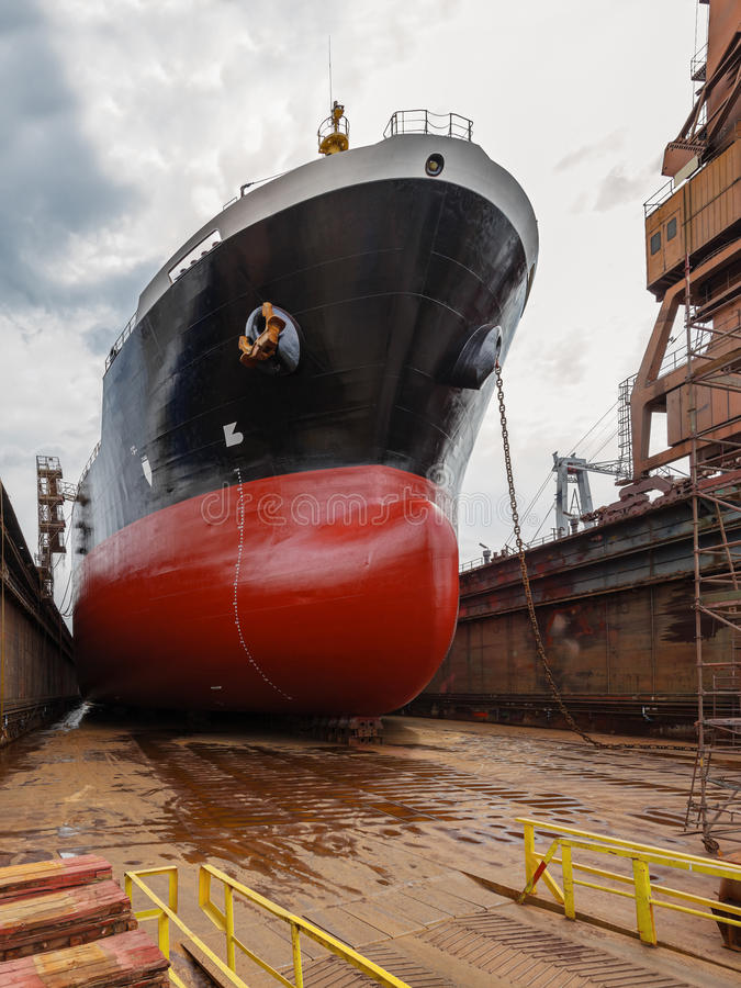 Tanker in dry dock. A large tanker ship is being renovated in shipyard Gdansk, Poland royalty free stock photography