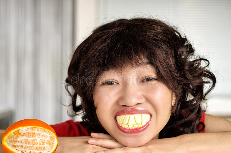 Large teeth joke. This is a joke, when she suddenly laughed, exposing the large teeth made of orange peel