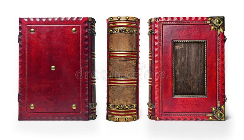 Large and thick aged red leather book with wooden plate. Large and thick aged red leather book with recessed wooden plate in the front cover, brass corners, rich stock photos