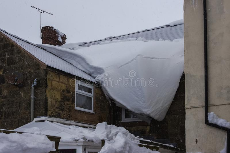Conservatory Roof Damaged By Snow Sliding Off Main Roof
