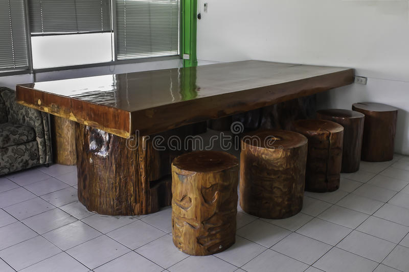 Large timber with wooden benches stock photos