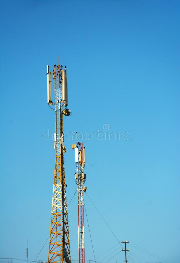 Large tower with antennas for communication and connection under clear blue sky. Large tower with antennas for communication of cell phones. 4G and 4.5G Cell royalty free stock photos