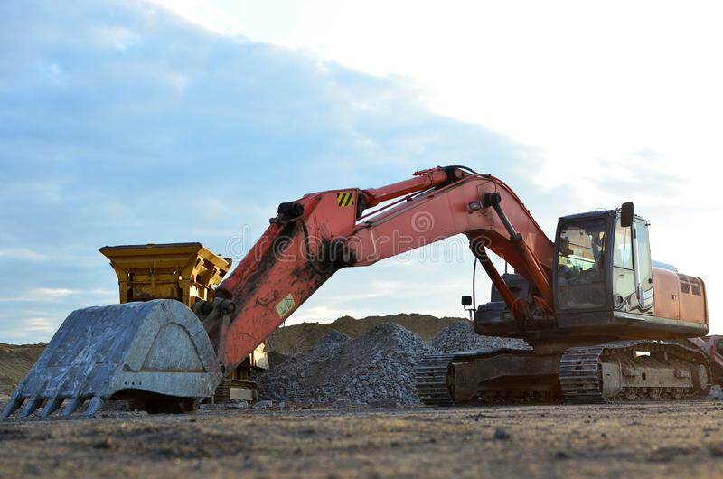 Large tracked excavator on a construction site stock image