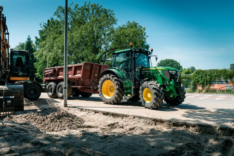 Large tractor with a trailer, work on the road royalty free stock photo