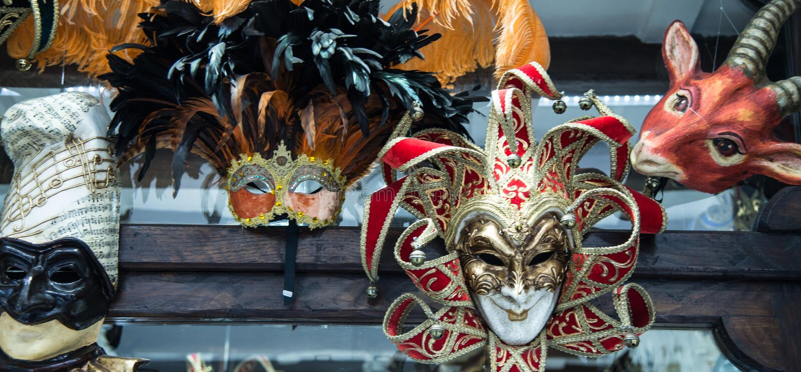 Traditional venetian mask in store on street, Italy stock photo